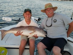 While Amelia Island Inshore Fishing, David and his grandson Henry show off their 38-inch Bull Redfish.