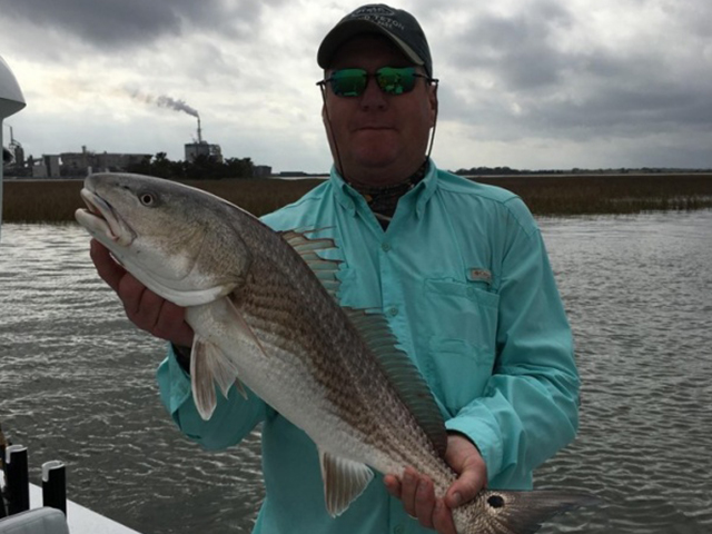 Steve holds a 28-inch Redfish caught on his Amelia Island Charter Fishing trip.