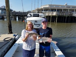 Inshore Fishing Amelia Island, Jim and Charlene show off their Speckled Trout Redfish