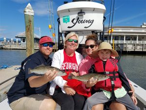 Family of Four Display Their Catch On Fernandina Beach Inshore Fishing Boat