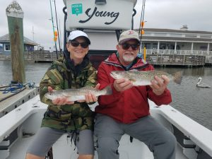Men on Boat holding Speckled Trout Caught Amelia Island Charter Fishing