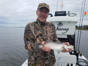 Man holding Speckled Trout Caught Amelia Island Inshore Fishing