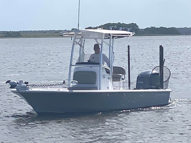Cpt Brian Soucy standing in his Amelia Island Inshore Charter Fishing Boat